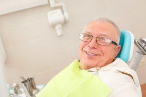 older man in dentist chair smiling