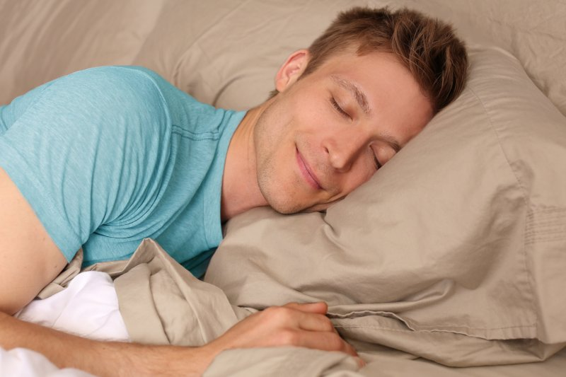 man sleeping peacefully on pillow
