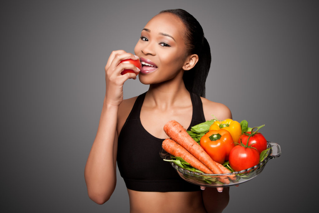woman smiling eating healthy foods