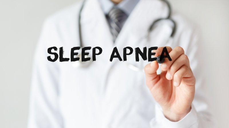 "a doctor writing the words ""sleep apnea"""