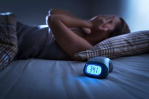 Woman who is having trouble sleeping in bed