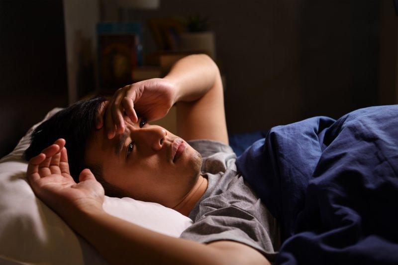 Man having just woken up from a nightmare