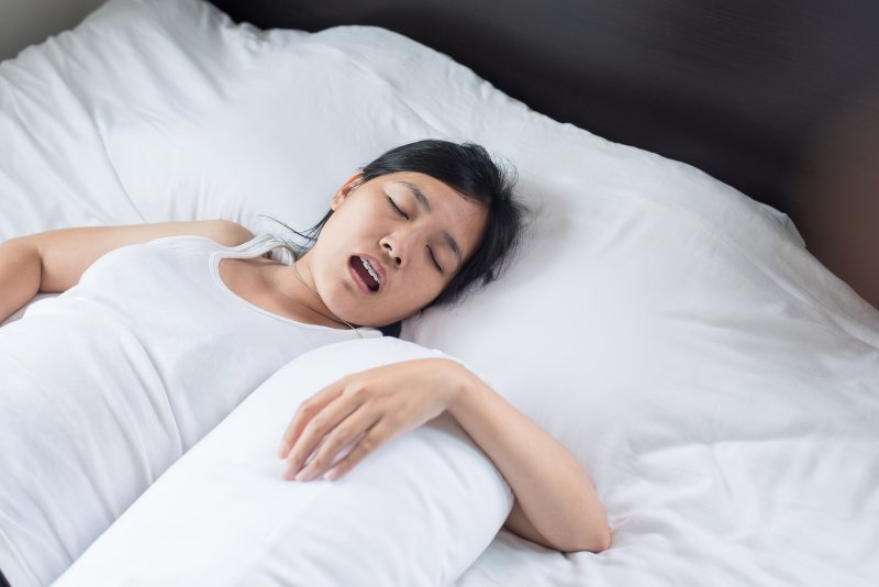 Young woman sleeping on back and snoring